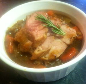 sliced turkey served over braise