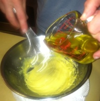 adding oil to mayo